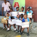 children opening care packages